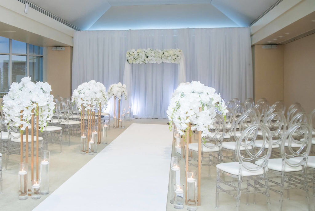 Modern, elegant wedding ceremony set up with gorgeous ambient lighting. Room is equipped with a discrete state of the art sound system, ceiling projector and free wifi.